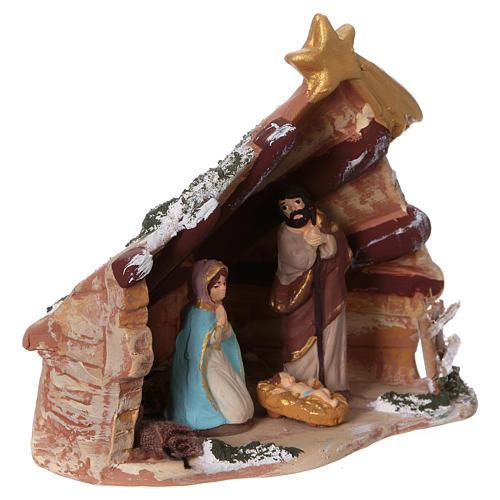 Coloured terracotta hut with 6 cm Nativity scene and comet made in Deruta 2