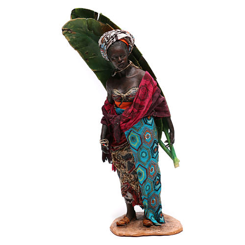 Mujer con hojas de plátano 30 cm belén Tripi 1
