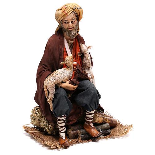 Shepherd sitting with sheep, 30 cm Angela Tripi figurine 5