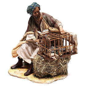 Hombre con jaula de pájaros 30 cm belén Tripi s3