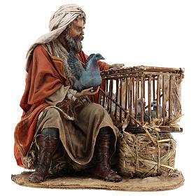 Homme avec cage d'oiseaux 30 cm crèche Tripi s1