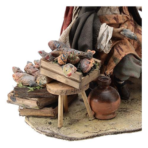 Nativity scene figurine, Fishmonger by Angela Tripi 13 cm 2