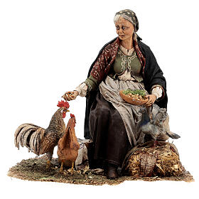 Woman sitting with chickens, 30 cm Tripi s1