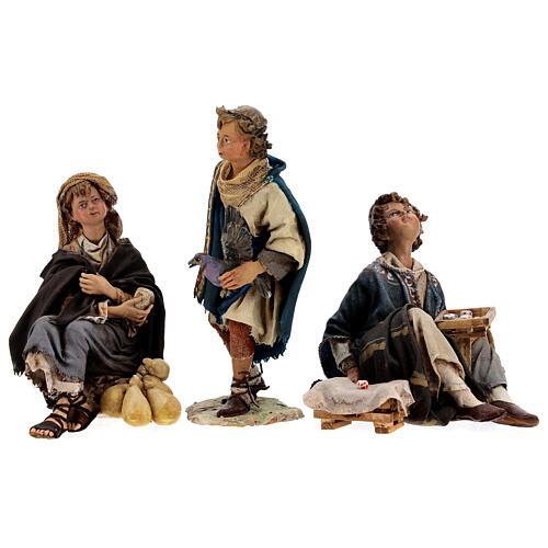 Groupe 3 garçons qui jouent 18 cm Tripi 10