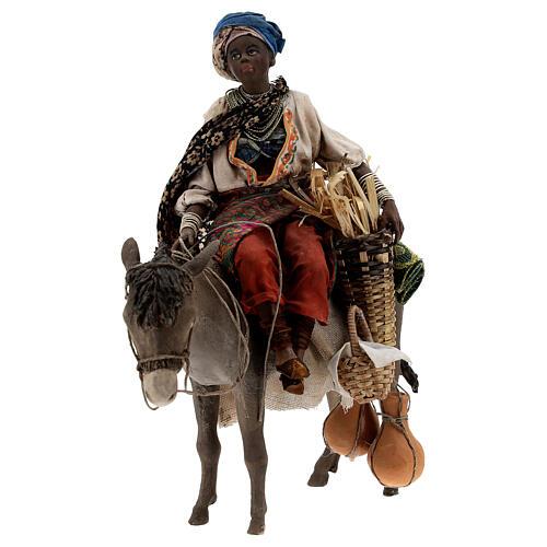 Femme maure sur âne 18 cm crèche Angela Tripi 5