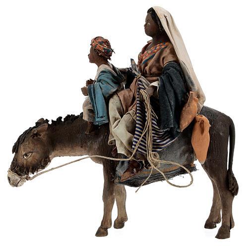 Morena con niño y burro cm 13 Tripi 1