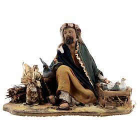 Shepherd sitting with doves, 13 cm Tripi nativity s1
