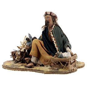 Shepherd sitting with doves, 13 cm Tripi nativity s3