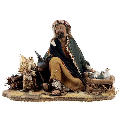 Shepherd sitting with doves, 13 cm Tripi nativity 1