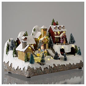 Christmas village with moving snowman  25x35x15 cm s4