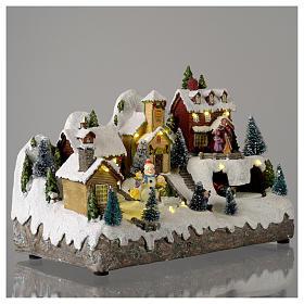 Pueblo Navideño en miniatura con muñeco de nieve movimiento 25x35x15 cm s4
