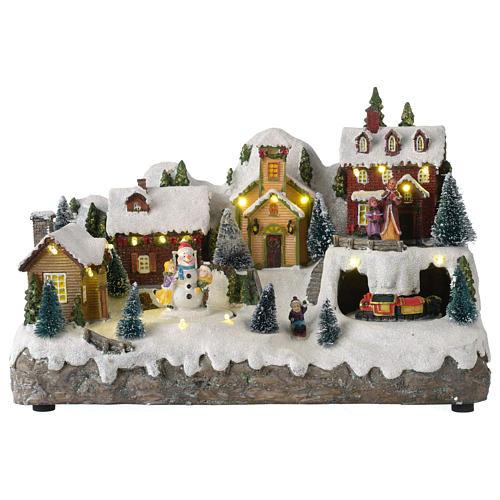 Pueblo Navideño en miniatura con muñeco de nieve movimiento 25x35x15 cm 1