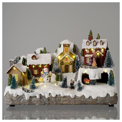 Pueblo Navideño en miniatura con muñeco de nieve movimiento 25x35x15 cm 2