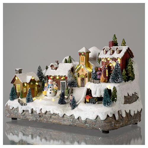 Pueblo Navideño en miniatura con muñeco de nieve movimiento 25x35x15 cm 3