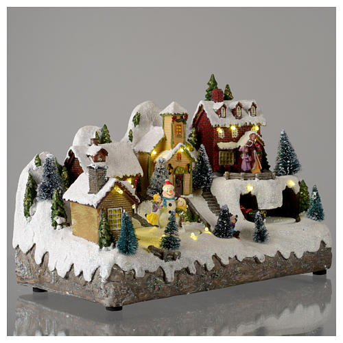 Pueblo Navideño en miniatura con muñeco de nieve movimiento 25x35x15 cm 4