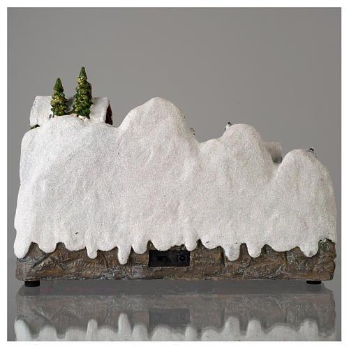 Pueblo Navideño en miniatura con muñeco de nieve movimiento 25x35x15 cm 5