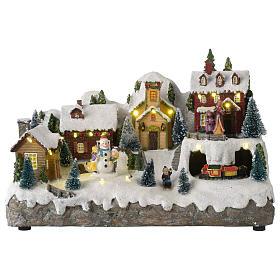 Villaggio natalizio con pupazzo di neve in movimento 25x35x15 cm s1