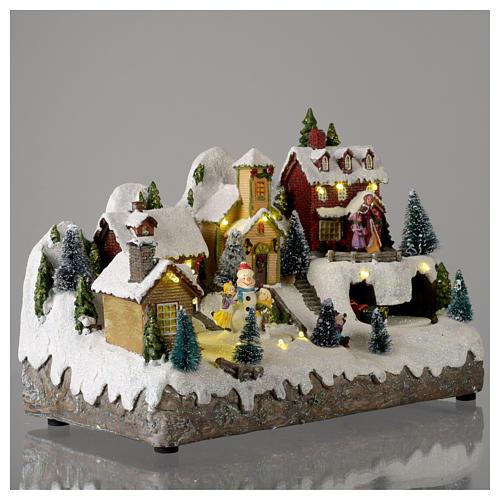 Villaggio natalizio con pupazzo di neve in movimento 25x35x15 cm 4