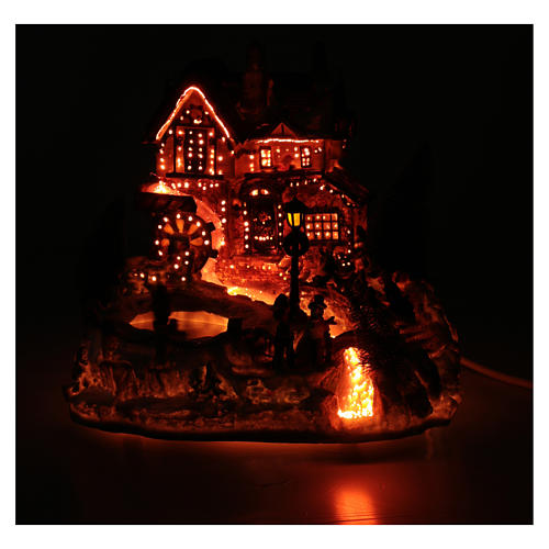 Winter village with ice skating rink, movement and lights 25x30x30 cm 5