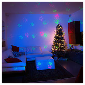 Christmas laser lights projectors: Christmas laser lights projector blue with Christmas decorations for interiors