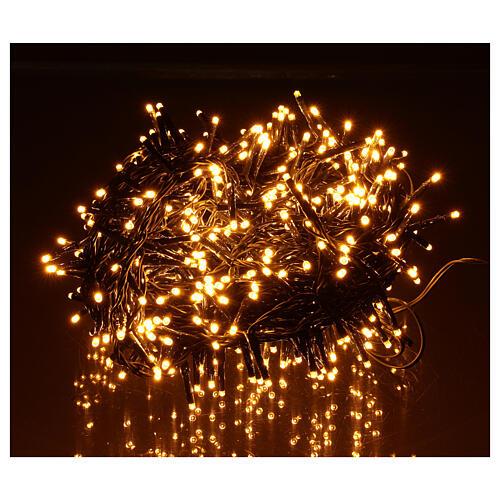Pisca pisca 500 LED branco quente ambarino com jogos de luzes programáveis 2