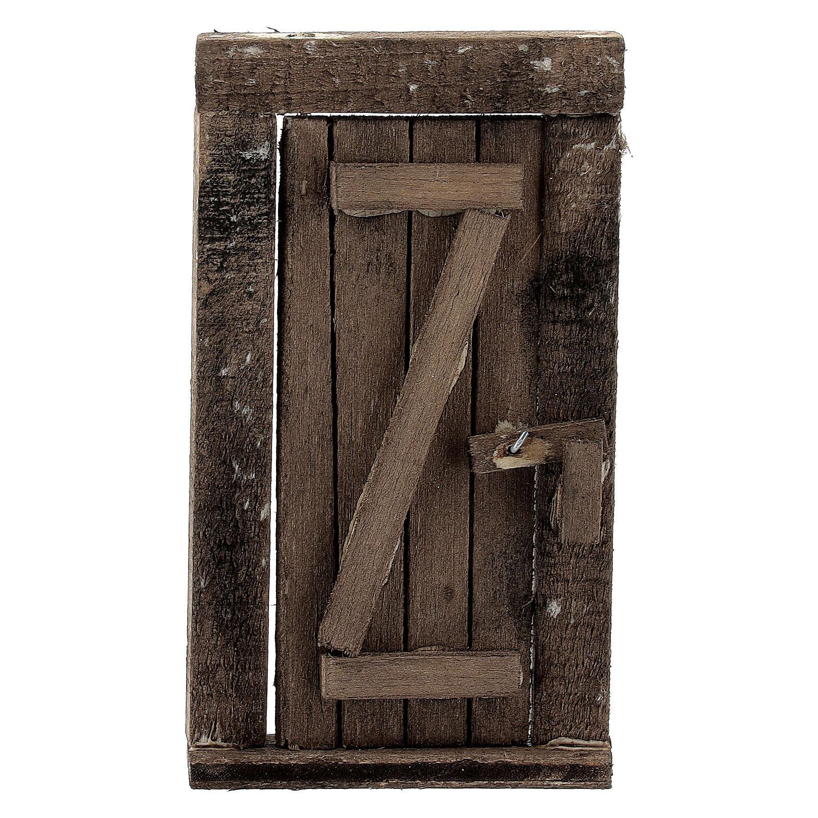 Puerta 1 ante en madera con clavados 9x5 cm 4