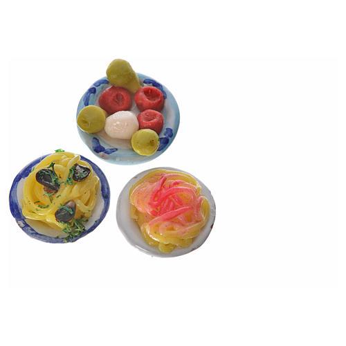 Piatto terracotta con pasta condimenti assortiti cera diam 2,5 3