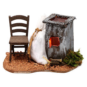Illuminated nativity scene with roasted chestnuts and chair 6x12x7cm s1