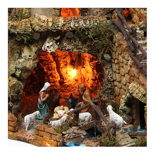 Illuminated nativity setting with stable, houses and mill 42x59x35cm 2