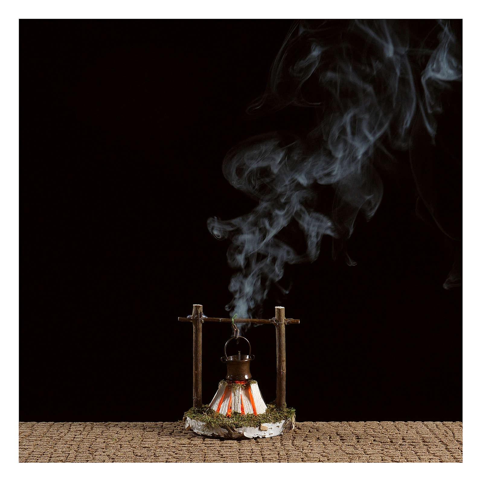 Fuego con olla y humo 4,5V h.7 cm 4