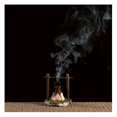 Fuego con olla y humo 4,5V h.7 cm 2