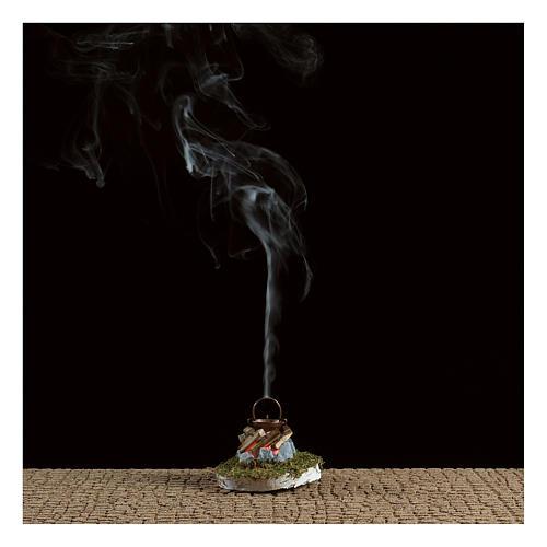 Fuoco presepe con fumo 4,5V h. 6,5x3,5cm 2