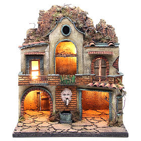 Neapolitan Nativity Scene: Illuminated village with 2 stables and a fountain 40x40x30cm