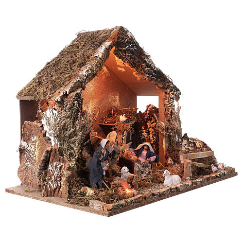 Nativity stable with moving figurines of 15cm, illuminated 46x57x38cm 5