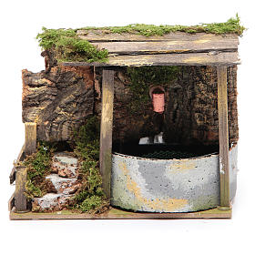 Electric fountain in rocky environment for nativity scene sized 10x15x10 cm s1