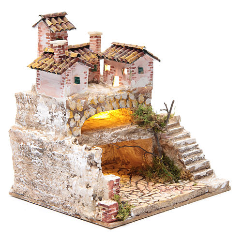 Nativity scene with a cave and a group of houses 25x25x20 cm 3