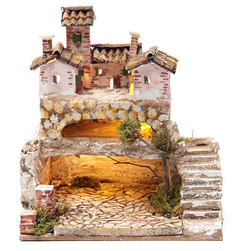 Nativity scene with a cave and a group of houses 25x25x20 cm 1