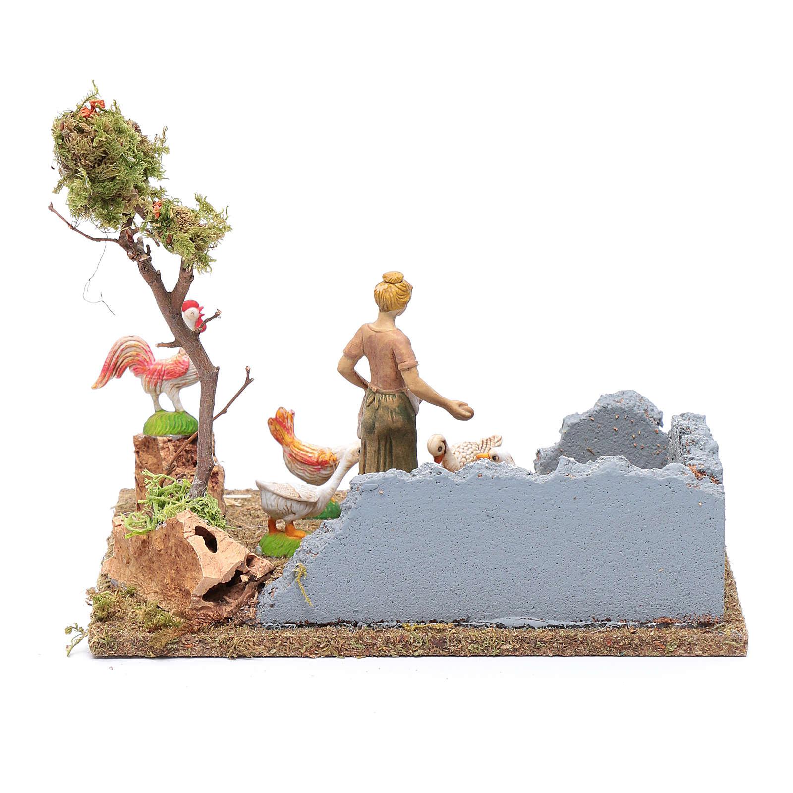 Rolniczka w zagrodzie z drobiem do szopki 15x20x15 cm 3