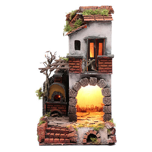 Neapolitan nativity scene setting composed by house with chimney and lights 1