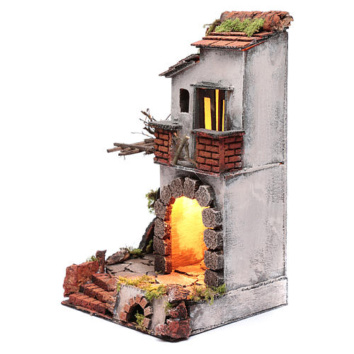 Neapolitan nativity scene setting composed by house with chimney and lights 2