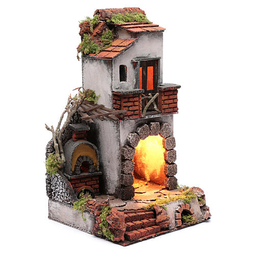 Neapolitan nativity scene setting composed by house with chimney and lights 3