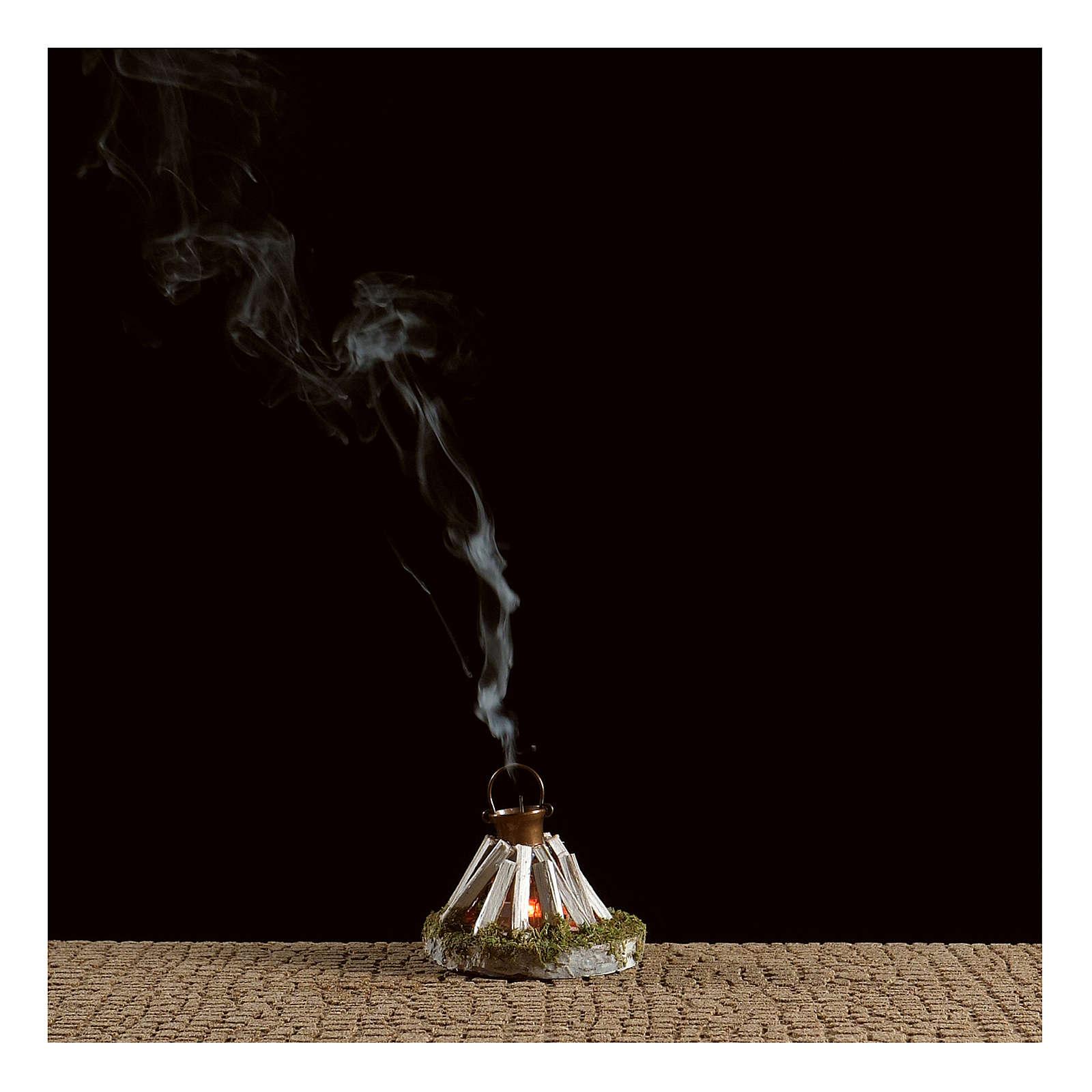 Olla sobre fogata y leña con generador de humo 4,5V 4