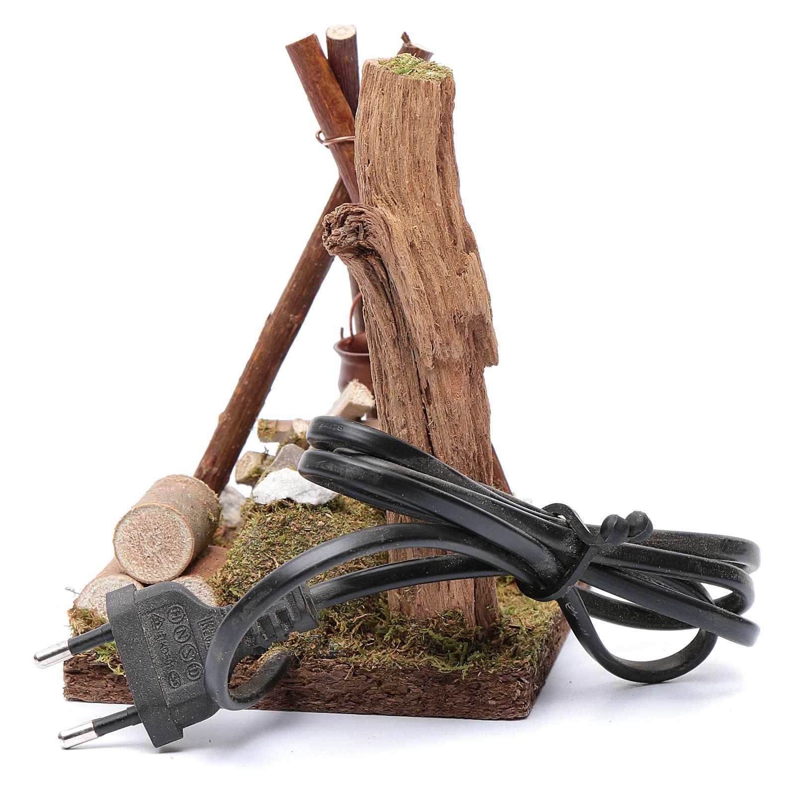 Casserole et bois disposés pour bivouac 230 V 4
