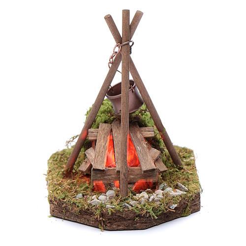Scène camp avec feu et casserole 230 V 1