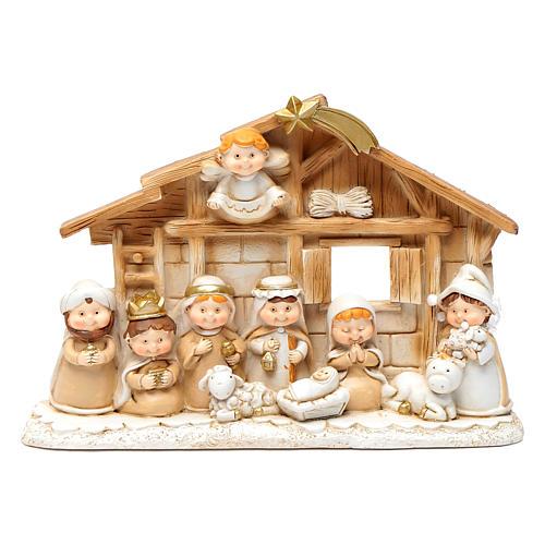 Pequeña cabaña belén niños 15x20 cm resina 1