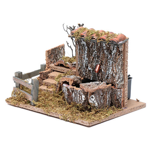 Nativity scene fountain with pump on rocky wall and roof 2