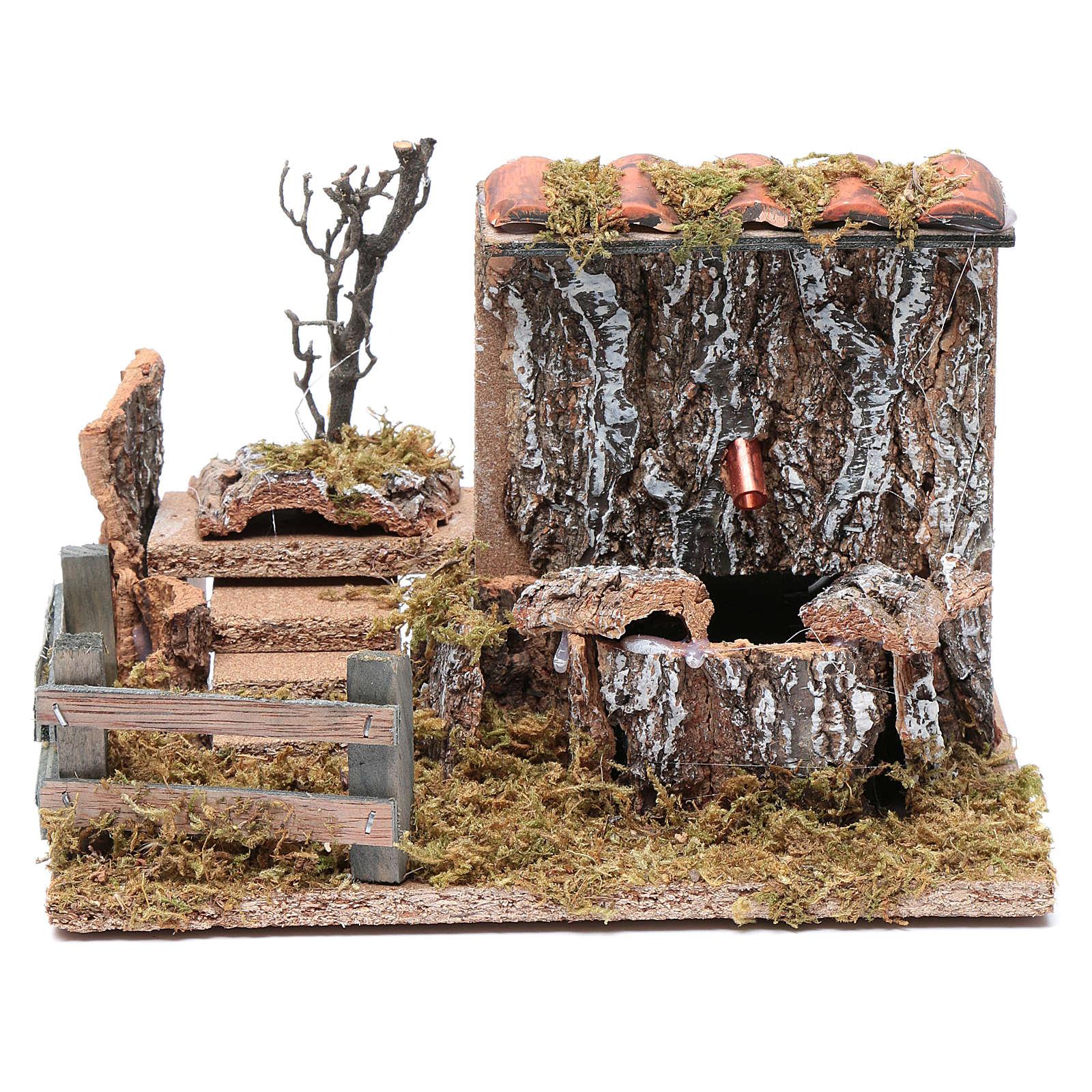 Fontana con pompa su parete rocciosa e tetto per presepe 15x20x10 cm 4