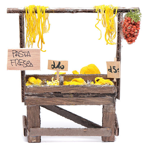 Banquete con pasta y carteles belén napolitano 1