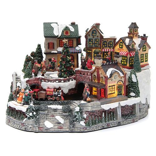Weihnachtsdorf, mit Bahnhof und Zug, aus Kunstharz, 35x25x20 cm 1