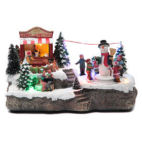 Christmas village with Ring a Ring-o' roses game and snowman  25x15x15 cm s1